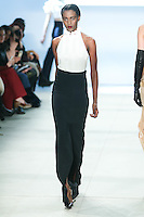 Kai Newman walks the runway wearing Cushnie et Ochs Fall 2016, hair by Antonio Corral Calero for Moroccanoil, makeup by Val Garland, photographed by Thomas Concordia during New York Fashion Week on February 12, 2016