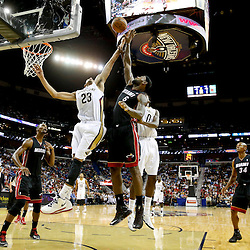 Oct 23, 2013; New Orleans, LA, USA; New Orleans Pelicans power forward Anthony Davis (23) battles for a rebound with Miami Heat small forward LeBron James (6) during the first half of a preseason game at New Orleans Arena. Mandatory Credit: Derick E. Hingle-USA TODAY Sports