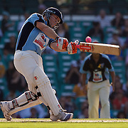 David Warner in action during Australia's Big Bash Cricket match to raise money for the Victorian Bushfire Appeal at the Sydney Cricket Ground, Sydney, Australia on February 22, 2009. The match was attended by over 20,000 spectators. Photo Tim Clayton