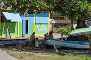 Family taking a break in the shade by Admiralty Bay Bequia West Indies