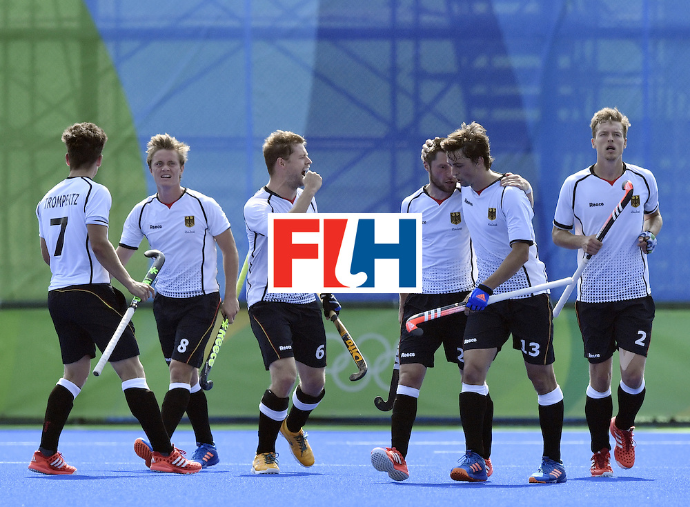 Germany's Martin Haner (2nd L) celebrates a goal with teammates during the men's Bronze medal field hockey Netherlands vs Germany match of the Rio 2016 Olympics Games at the Olympic Hockey Centre in Rio de Janeiro on August 18, 2016. / AFP / PHILIPPE LOPEZ        (Photo credit should read PHILIPPE LOPEZ/AFP/Getty Images)