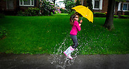 Rebecca Gibbs, 11, plays in the rain in front of her home on Pinehurst Road in Springettsbury Township, Wednesday May 18, 2011..John A. Pavoncello photo