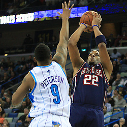 21 January 2009:  New Jersey Nets forward Jarvis Hayes (22) shoots over New Orleans Hornets guard Morris Peterson (9) during a 102-92 win by the New Orleans Hornets over the New Jersey Nets at the New Orleans Arena in New Orleans, LA. .
