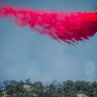 An air tanker drops fire retardant on The Holcomb Fire as it burns in the Holcomb Valley are of the San Bernardino National Forest near Big Bear, Tuesday, June 20, 2017. Firefighters are battling a wildland fire north of Baldwin Lake in the Big Bear Lake area had charred 950 acres, and was 10 % contained. (EricReed/For The Souther California Newspaper Group)