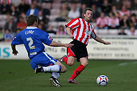 Photo: Pete Lorence.<br />Lincoln City v Stockport County. Coca Cola League 2. 07/04/2007.<br />Robert Clare and Peter Holmes battle for the ball.