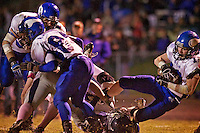 Coeur d'Alene High's Joe Roletto crashes over a Lake City player at the end of his 41-yard catch-and-run to put the Viking's in a first and goal from the four-yard line during the second half of the Viking's 62-21 win Thursday over Lake City.
