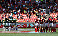 South Africa and Canada huddle for a Minutes Silence in remembrance of Former South African President Nelson Mandela who passed away on Thursday during the match between South Africa and Canada of the HSBC Sevens World Series Port Elizabeth Leg held at the Nelson Mandela Bay Stadium on 7th December 2013 in Port Elizabeth, South Africa. Photo by Shaun Roy
