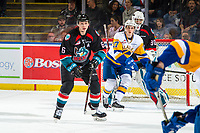 KELOWNA, CANADA - DECEMBER 1: Kaedan Korczak #6 of the Kelowna Rockets looks for the pass to Eric Florchuk #17 of the Saskatoon Blades  on December 1, 2018 at Prospera Place in Kelowna, British Columbia, Canada.  (Photo by Marissa Baecker/Shoot the Breeze)