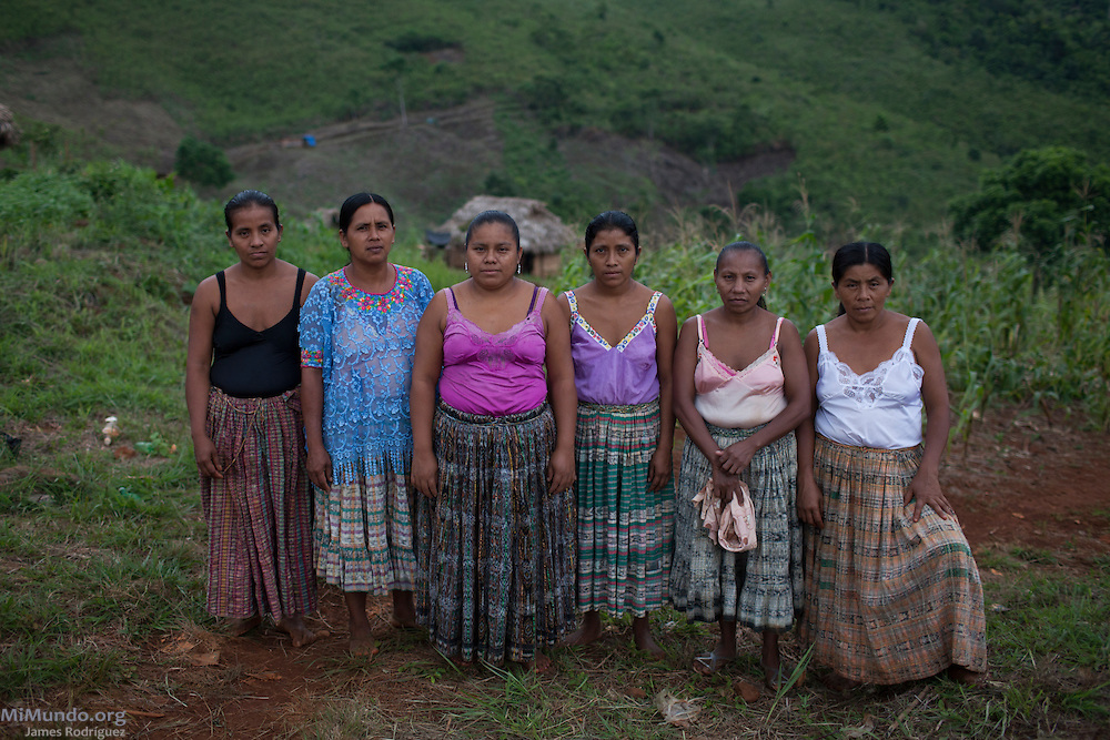 From left to right: Carmelina Caal Ical, Margarita Caal Caal, Rosa Elbira Coc Ich, Amalia Cac Tiul, Lucia Caal Chun, and Olivia Asig Xol, all six women plaintiffs in the Caal vs. HudBay legal case in Canada, pose for a photograph in their community of Lote 8. The Q'eqchi' Mayan community of Lote 8 was violently evicted on January 17, 2007, by State forces at the orders of the Guatemalan Nickel Company (CGN), then-owned by Canadian mining firm Skye Resources. During the eviction, numerous local women were gang-raped by Police officers and CGN security personnel. In a landmark legal case, eleven women from Lote 8 are suing HudBay Minerals Inc., the mining firm that purchased Skye in 2008, in the home jurisdiction of Ontario, Canada, for negligence and carelessness causing physical and psychological harm. Lote 8, El Estor, Izabal, Guatemala. September 29, 2014.