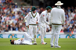 South Africa's Dean Elgar (floor) reacts after colliding with a team mate in the field during day one of the 3rd Investec Test match at the Kia Oval, London.