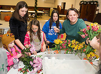 Grace and Reid Aillancourt, Zoe Glines, Andy Hazelton and Chandra Hazelton work on flower arrangements for the annual Hazel Duke Thanksgiving Day dinner at the Congregational Church on Wednesday morning.  (Karen Bobotas/for the Laconia Daily Sun)