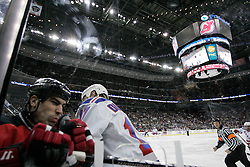Feb 9, 2009; Newark, NJ, USA; New York Rangers center Brandon Dubinsky (17) hits New Jersey Devils defenseman Mike Mottau (27) during the first period at the Prudential Center.