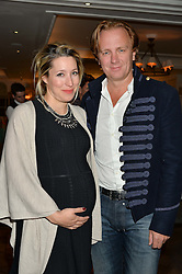 PRINCE & PRINCESS VALERIO MASSIMO at a party hosted by Ewan Venters CEO of Fortnum & Mason to celebrate the launch of The Cook Book by Tom Parker Bowles held at Fortnum & Mason, 181 Piccadilly, London on 18th October 2016.