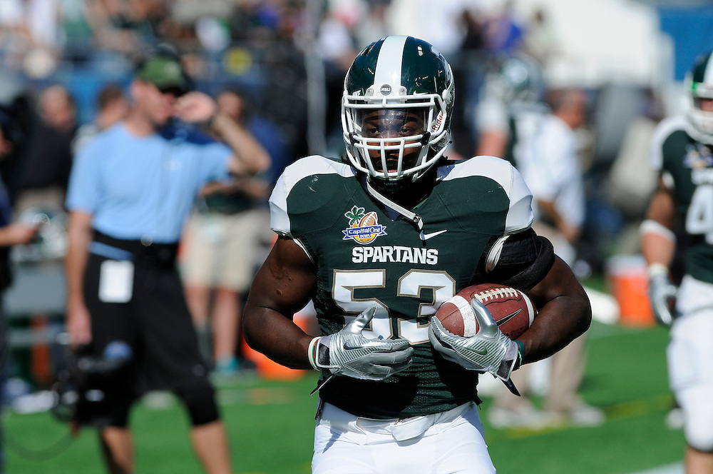 January 1, 2011: Greg Jones of the Michigan State Spartans in action during the NCAA football game between MSU and the Alabama Crimson Tide at the 2011 Capital One Bowl in Orlando, Florida. Alabama defeated Michigan State 49-7.