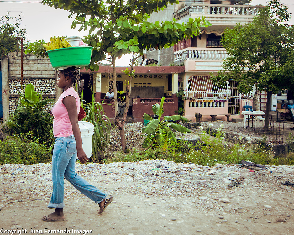 Haiti, Les Cayes, a Country fighting to survive. Even the deepest poverty can't hide the colors and textures of the life that waits to surface and bloom.