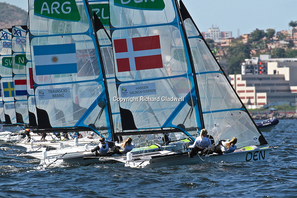 49erFX fleet powers off at the start of Race 4, 2016 Olympic Sailing Regatta.<br /> Rio 2016 Olympics, Rio de Janero, Brazil. Olympic Sailing Day 6, 13 August 2016.<br /> Photo credit: Richard Gladwell / www.photosport.nz