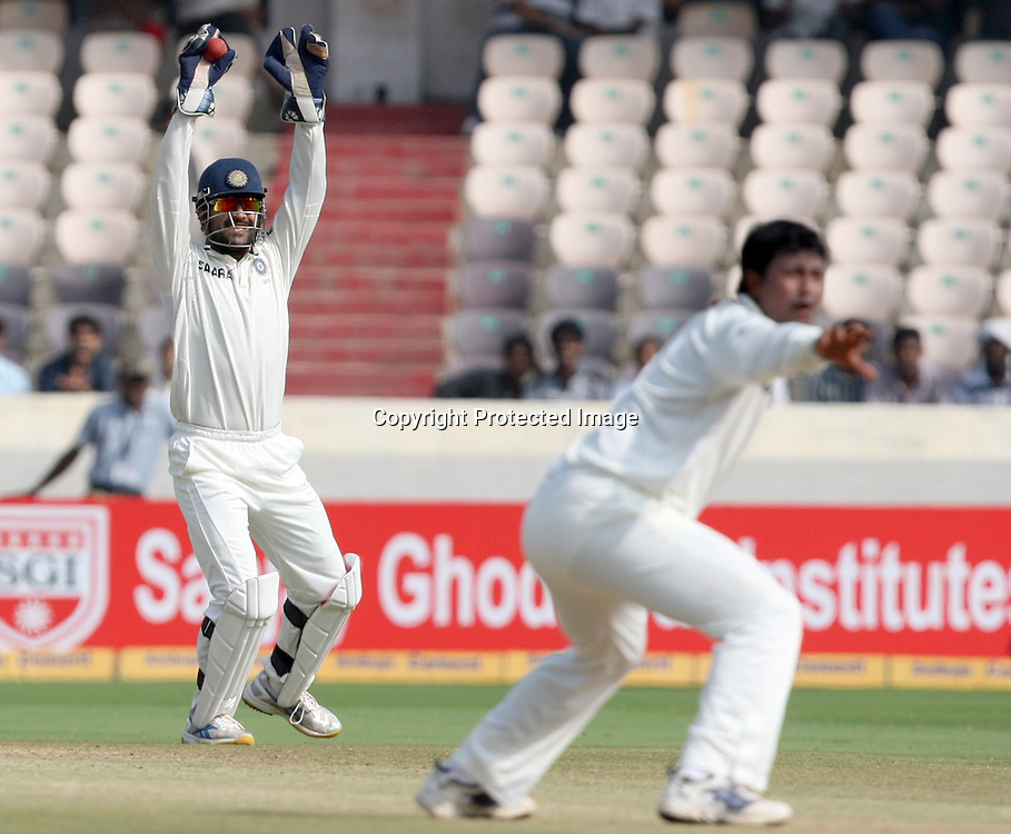 Indian captain MS Dhoni and Pragiyan Ojha appile against New Zealand batsman Kane Williamson during the Indian vs New Zealand 2nd test match day-5 Played at Rajiv Gandhi International Stadium, Uppal, Hyderabad 16 November 2010 (5-day match)