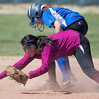 050213       Cable Hoover<br /> <br /> Zuni Thunderbird Tyanna Neveyaktewa (8) tags up on second base as Tohatchi Cougar Cheyenne Shorty (9) reaches for the ball Thursday at Tochatchi High School.