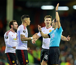 LIVERPOOL, ENGLAND - Thursday, March 10, 2016: Manchester United's Marcos Rojo, Juan Mata and Michael Carrick argue with referee Carlos Velasco Carballo during the UEFA Europa League Round of 16 1st Leg match against Liverpool at Anfield. (Pic by David Rawcliffe/Propaganda)