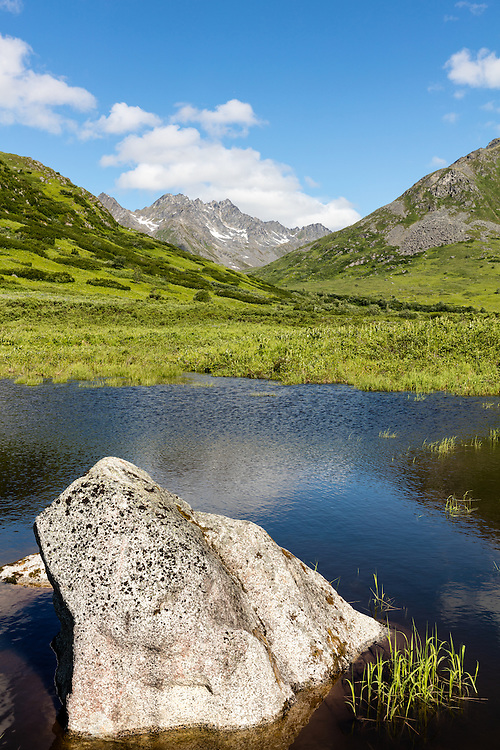 Talkeetna Mountains and pond in Archangel Valley at Hatcher Pass State Recreation Area in Southcentral Alaska. Summer. Morning.