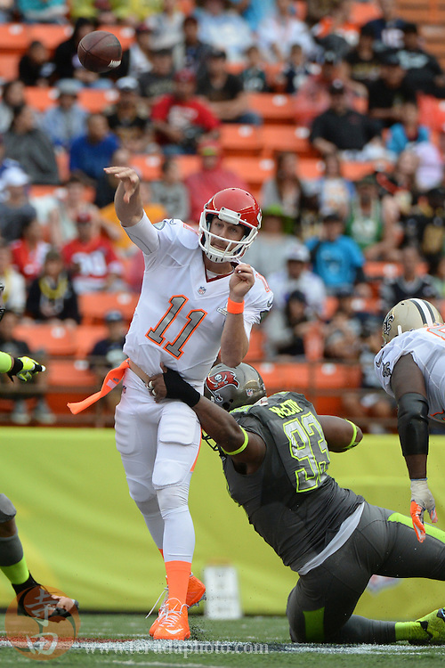 January 26, 2014; Honolulu, HI, USA; Team Rice quarterback Alex Smith of the Kansas City Chiefs (11) passes the football against Team Sanders defensive tackle Gerald McCoy of the Tampa Bay Buccaneers (93) during the third quarter of the 2014 Pro Bowl at Aloha Stadium. Team Rice defeated Team Sanders 22-21.