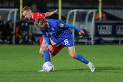 AFC Wimbledon attacker Marcus Forss (15) battles for possession during the Leasing.com EFL Trophy match between AFC Wimbledon and Leyton Orient at the Cherry Red Records Stadium, Kingston, England on 8 October 2019.