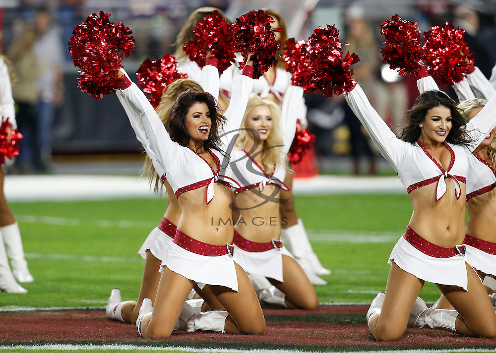 The Arizona Cardinals cheerleaders perform during the first half of an NFL football game against the Minnesota Vikings, Thursday, Dec. 10, 2015, in Glendale, Ariz. (AP Photo/Rick Scuteri)