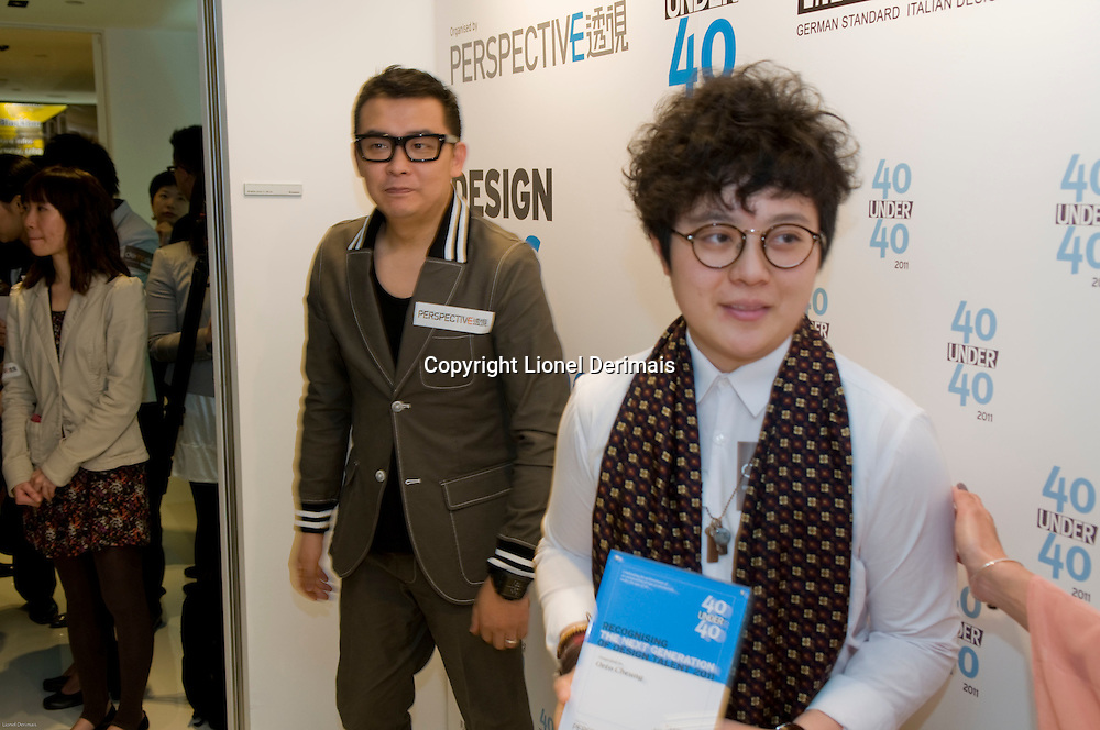 Fashion designer Ms Octo Cheung (R) receives her 40 Under 40 Perspective magazine award.