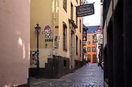Coronavirus / Covid 19 outbreak, April 7th. 2020. The deserted Salzgasse in the old town, Cologne, Germany.<br /> <br /> Coronavirus / Covid 19 Krise, 7. April 2020. Die menschenleere Salzgasse in der Altstadt,  Koeln, Deutschland.
