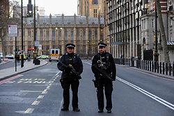 © Licensed to London News Pictures. 22/03/2017. London, UK. Armed police are seen on Victoria Embankment outside the Houses of Parliament after Assistant Commissioner Mark Rowley gaves a statement to the media outside New Scotland Yard. He said that four people had been killed (two on bystanders on Westminster Bridge, a policeman stabbed, the assailant who was shot by police) and 20 people injured.  Mr Rowley also said that the situation was being treated as a terrorist incident. Photo credit : Stephen Chung/LNP