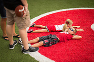 Jamison Theis, 6, and his sister, Avery, 4, of West Point, Neb., take a break in the endzone during Nebraska's annual Fan Day at Memorial Stadium on Aug. 5, 2015. Photo by Aaron Babcock