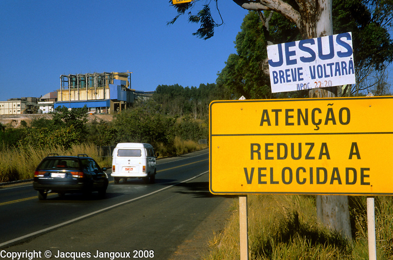 Humor: road signs: Reduce speed, Jesus will come back soon on highway between Brasilia and Belo Horizonte, Brazil..Bilingual Portuguese English sign saying No Surfing at Boa Viagem Beach Recife Pernambuco Brazil