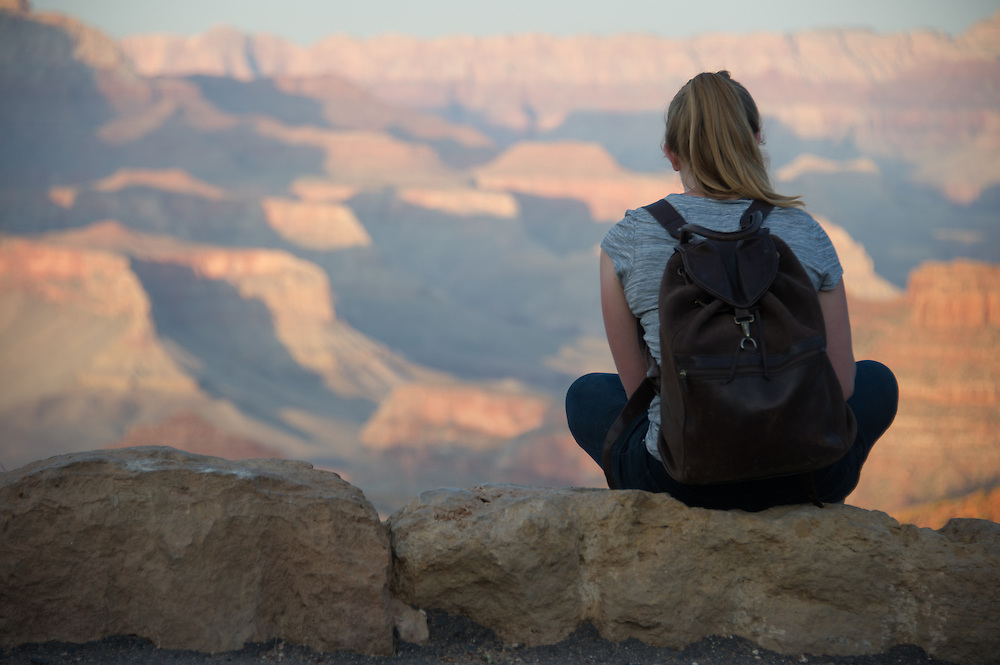 Young Woman Sitting in Grand Canyon
