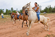 "09 SEPTEMBER 2007 -- ST. MICHAELS, AZ: The start of the ""Cowhand Race"" at a traditional Navajo Horse Race in the summit area of the Navajo Indian reservation about 10 miles west of St. Michaels, AZ. Traditional horse racing is making a comeback on the Navajo reservation. The races are run on improvised courses that vary depending on the local terrain. Use of saddles is optional (except in the ""Cowhand Race"" which requires a western style saddle) and many jockeys ride bareback. In the Cowhand Race, jockeys ride bareback for the first half, then saddle their horse, using a western style saddle, and complete the race in the saddle. The distances vary from one mile to as long as thirty miles. Traditional horse races were common until the 1950's when they fell out of favor, but there has been a resurgence in traditional racing since the late 1990's and now there is a traditional horse racing circuit on the reservation. The race was organized by the Begay family of Steamboat, AZ and run on private land about three miles from a paved road.  Photo by Jack Kurtz"