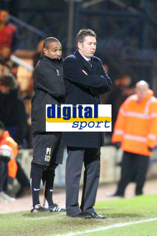Photo: Pete Lorence/Sportsbeat Images.<br />Peterborough United v Milton Keynes Dons. Coca Cola League 2. 15/12/2007.<br />Paul Ince and Duncan Ferguson watch over the match.