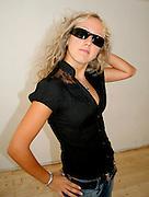 young beautiful teenager posing in studio