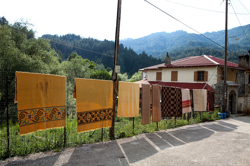 Carpets hanging out to dry after been washed  in Vovousa village.
