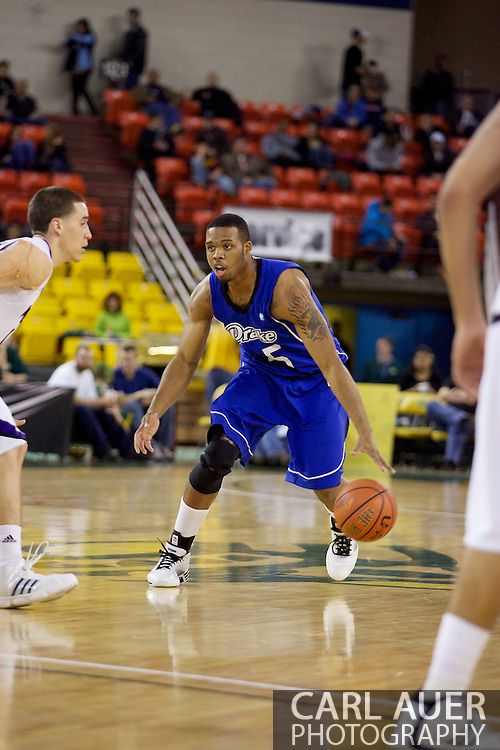 November 27th, 2010:  Anchorage, Alaska - Drake Bulldog David Smith (25) drives in the Bulldog's 81-82 loss to Weber State in the third place game of the Great Alaska Shootout.