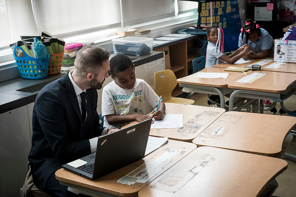 Eric Christopher, Leap ELA Instructional Coach at Turner Elementary School in Washington, D.C., helps a student with his work during class on Wednesday, May 4, 2017.