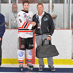 """FORT FRANCES, ON - May 2, 2015 : Central Canadian Junior """"A"""" Championship, game action between the Fort Frances Lakers and the Soo Thunderbirds, Championship game of the Dudley Hewitt Cup. Nicolas Tassone #17 of the Soo Thunderbirds receives the player of the game award.<br /> (Photo by Shawn Muir / OJHL Images)"""