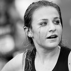 Mascara runs down the face of Alise Mecham, from Hillcrest High School at the finish line of the Girls 5A Idaho State Cross Country Championship held at Eagle Island State Park. Saturday November 1, 2014