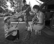 Joe Craven and Phoebe Hunt jamming outside the Village Green performing venue at The Sisters Folk Festival.  2009