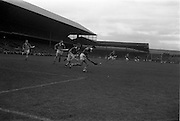 06/09/1964<br /> 09/06/1964<br /> 6 September 1964<br /> All-Ireland Senior Final: Tipperary v Kilkenny at Croke Park, Dublin.<br /> Tipperary goalie, J. O'Donoghue (right) comes out of the goal mouth to clear with Kilkenny left full forward, T. Murphy (center), and Tipperary right full back, J. Doyle (left), in pursuit.
