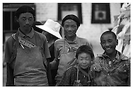 These Tibetan boys prostrate around the Jokhang temple showing their dedication to Buddha.  The marks on their foreheads are proof of their efforts. Along with the smiles on their faces.<br />