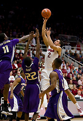 February 13, 2010; Stanford, CA, USA;  Stanford Cardinal guard/forward Landry Fields (2) shoots over Washington Huskies forward Justin Holiday (22) and forward Matthew Bryan-Amaning (11) during the first half at Maples Pavilion.  Washington defeated Stanford 78-61.