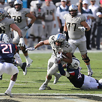 ORLANDO, FL - NOVEMBER 11: Marshe Terry #41 of the Connecticut Huskies tackles Gabriel Davis #13 of the UCF Knights during a NCAA football game between the University of Connecticut Huskies and the UCF Knights on November 11, 2017 in Orlando, Florida. (Photo by Alex Menendez/Getty Images) *** Local Caption *** Marshe Terry; Gabriel Davis