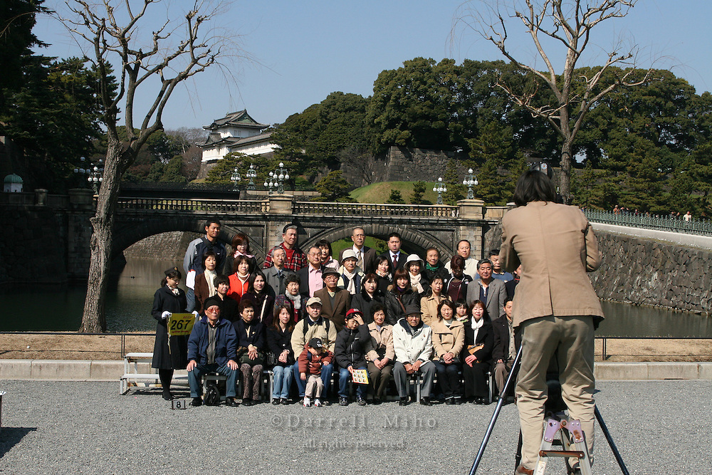 Mar 4, 2006; Tokyo, JPN; Imperial Palace.Visitors take a group picture in front of the Imperial Palace...Photo credit: Darrell Miho