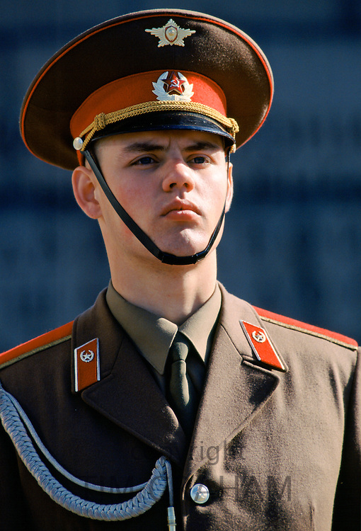 Armed guard at the Piskaryovskoye Memorial Cemetery in St Petersburg, Russia