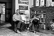 Stan and Sally Honey at home in Palo Alto, CA. Behind them are half-hull models of two of Roy Disney's PYWACKET boats, the Volvo 70 ABN AMRO, a model of GROUPAMA 3, and one of Stan's two Emmy Awards.