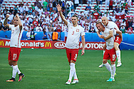 Nice, France - 2016 June 12: (L-R) Kamil Grosicki and Artur Jedrzejczyk and Kamil Glik and Michal Pazdan all of Poland celebrate their victory after Poland v Northern Ireland during Soccer European Championships UEFA EURO 2016 at Stadium Nice on June 12, 2016 in Nice, France.<br /> <br /> Adam Nurkiewicz declares that he has no rights to the image of people at the photographs of his authorship.<br /> <br /> Picture also available in RAW (NEF) or TIFF format on special request.<br /> <br /> Any editorial, commercial or promotional use requires written permission from the author of image.<br /> <br /> Mandatory credit:<br /> Photo by © Adam Nurkiewicz